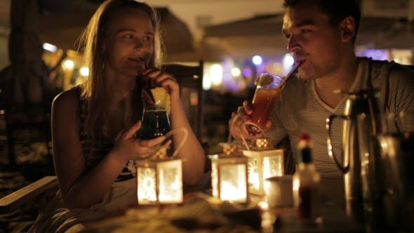 Thumbnail for Romantic Young Couple Enjoying Drinks In a Date