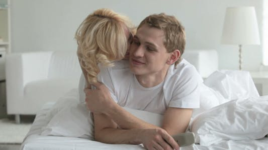 Thumbnail for Girl kissing guy in bed