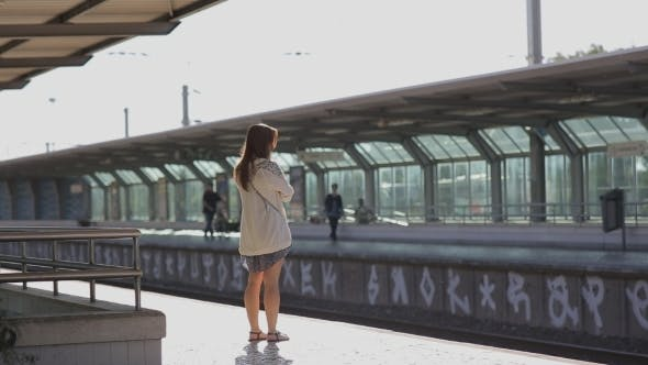 Thumbnail for Young Woman Waiting For a Train At Platform