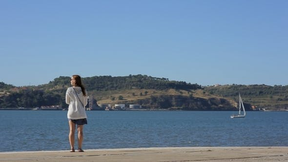 Thumbnail for Girl Walking Along The Waterfront
