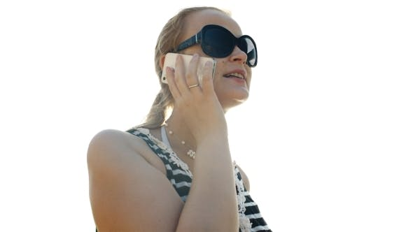 Thumbnail for Young Woman Talking On The Phone