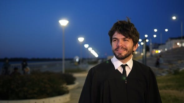 Thumbnail for Man Walking After the Graduation Ceremony