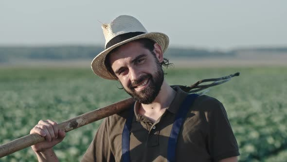 Thumbnail for Portrait of Smiling Farmer with Pitchfork