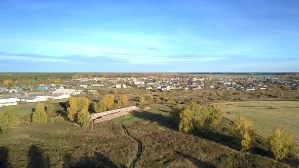 Thumbnail for Aerial Large Village with Livestock Complex Under Blue Sky