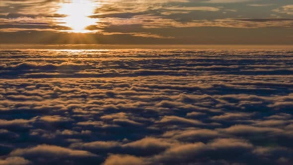 Timelapse of the sunset over clouds.