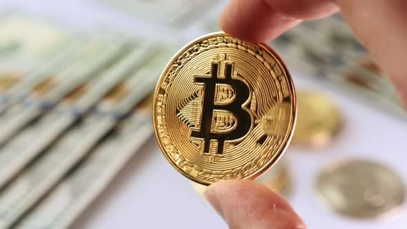 Bitcoin shining in hand