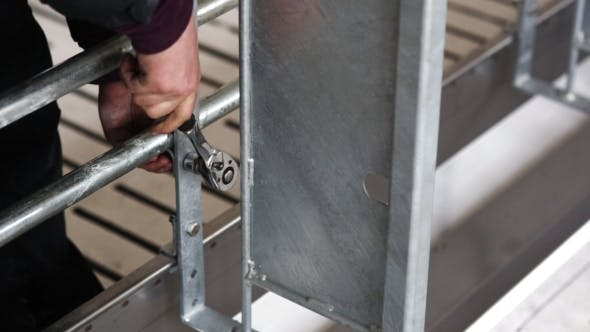 Cover Image for Man To Tighten The Screws With a Wrench