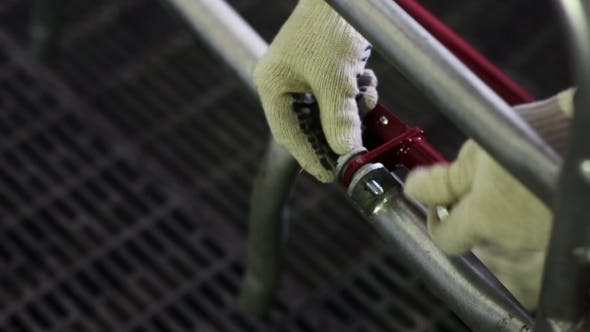 Thumbnail for Man Wearing Gloves Tighten The Bolt And Nut