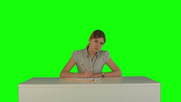 Thumbnail for Young Girl Sitting In Classroom At Lecture And