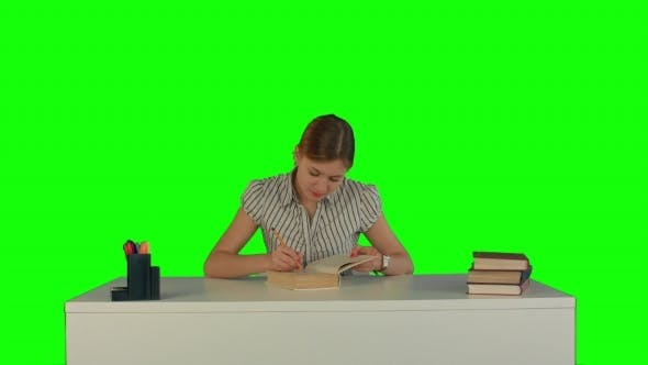 Thumbnail for Beautiful Female Student Read Book On a Green