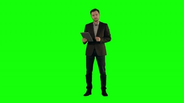 Thumbnail for Cool Businessman Using Electronic Tablet  On a