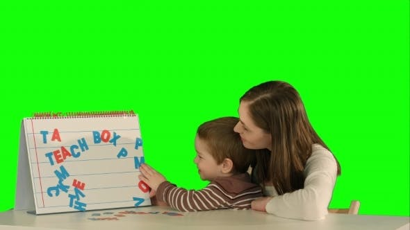 Thumbnail for Mother And Son Make Word Mama On The Desk On a