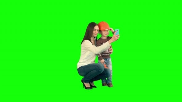 Boy Taking a Selfie With Her Mother On a Green