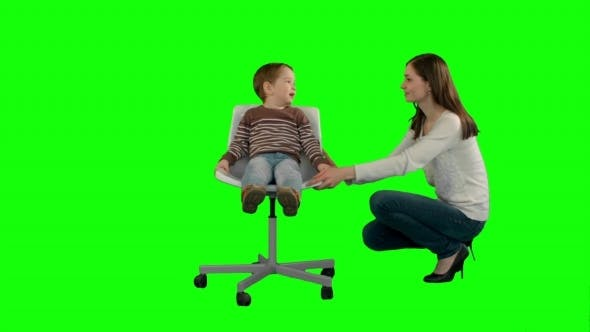 Thumbnail for Mother And Boy Play Game On a Green Screen