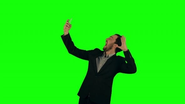 Thumbnail for Businessman Taking a Selfie On a Green Screen
