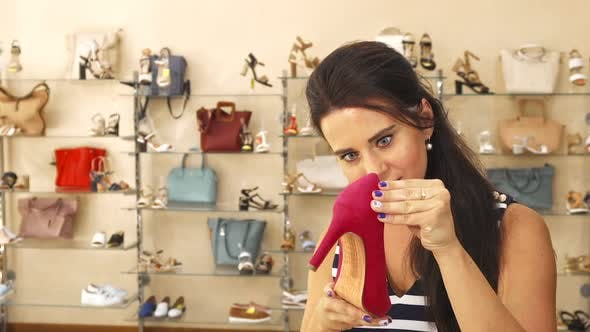 Thumbnail for Woman Examining Shoe in Store