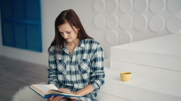Thumbnail for Young Woman Reading Book And Smiling