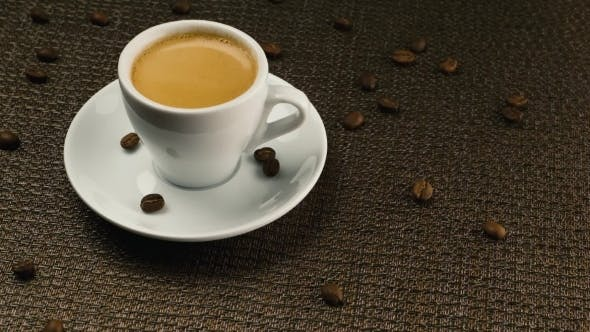 Thumbnail for A Cup Of Espresso On a Dark Napkin