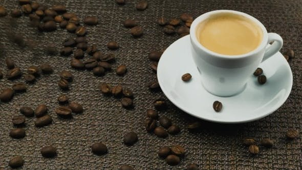 Thumbnail for A Cup Of Espresso, a Handful Of Coffee Beans