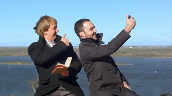 Thumbnail for Busineeman Giving Thumb-up And Making Selfies On