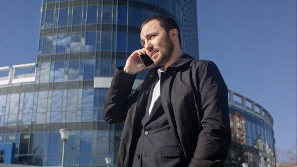 Thumbnail for Businessman Calling On Mobile Phone