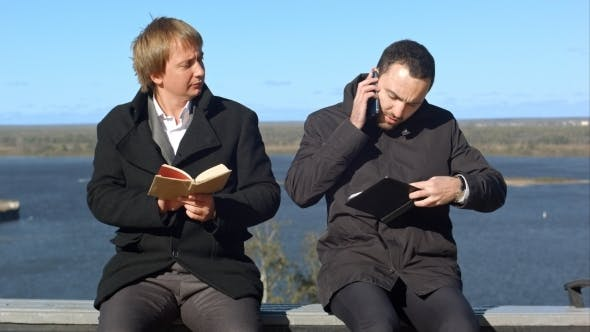 Thumbnail for Young Man On Phone Disturbs Man Withbook