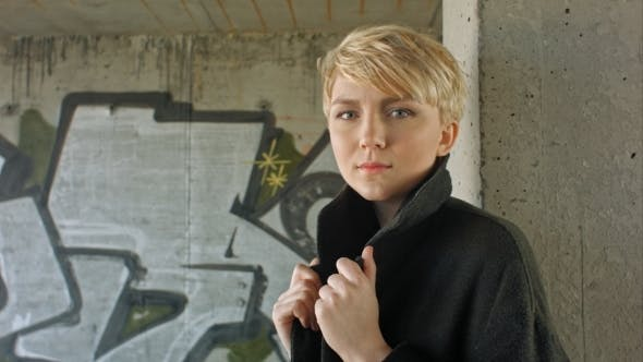 Thumbnail for Young Blond Girl With Modern Haircut Posing.