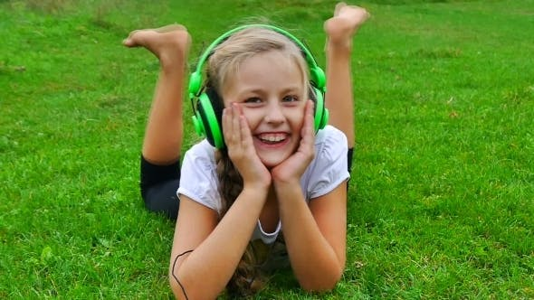 Thumbnail for Beautiful Young Woman With Headphones Outdoors