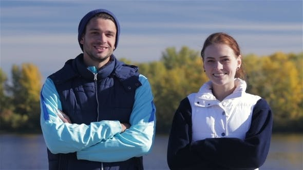 Thumbnail for Male And Female Joggers Smiling At The Camera