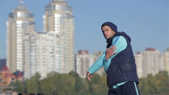 Thumbnail for Back View Of Fit Men Stretches Muscles Before
