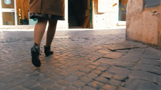 Thumbnail for Woman In a Hurry Running Along The Street