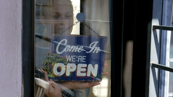 Thumbnail for Woman Changing Sign From Closed To Open