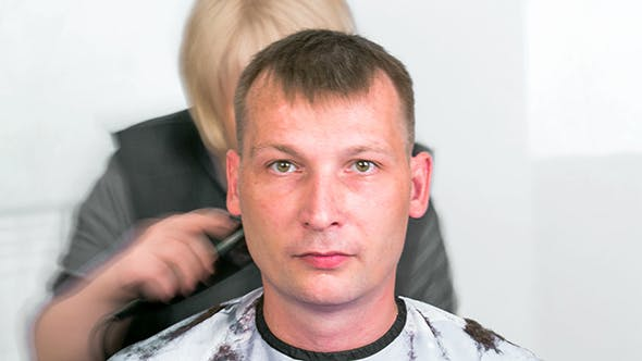 Cover Image for Barber Cutting Hair