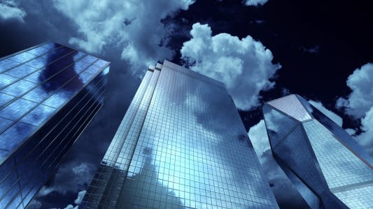 Cover Image for Skyscrapers at Night. Sky and Clouds Background