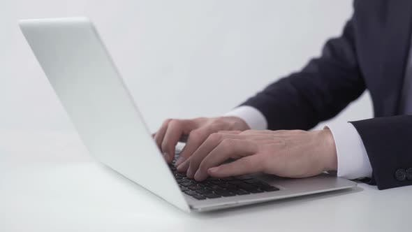 Thumbnail for Man Typing and Sending Email to Business Partner on Laptop, Working in Office