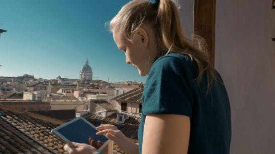 Thumbnail for Woman Using Pad On The Balcony With City View