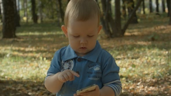 Adorable Baby Dialing Number On Mobile Phone.