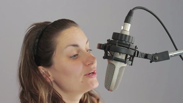 Thumbnail for Girl Sings In The Studio Microphone