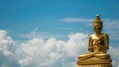 Buddha On Blue Sky