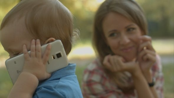 Thumbnail for Mother Watches Little Son Calling His Father With