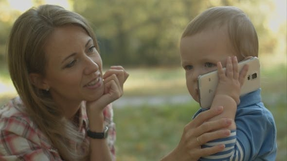 Thumbnail for Mother Helps Little Son To Call His Father With