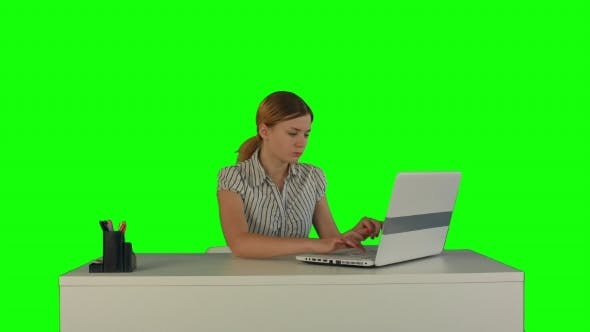 Thumbnail for Businesswoman Working On Laptop On a Green Screen