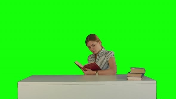 Thumbnail for Female Student Reading a Book For Finding