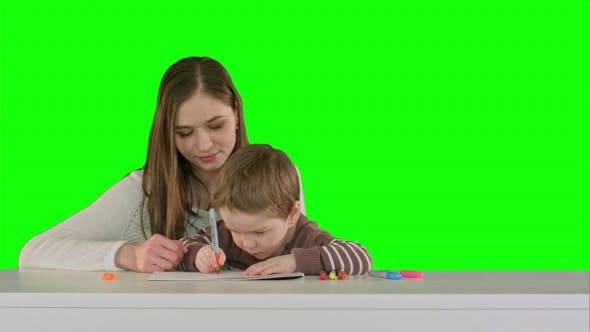 Thumbnail for Mom And Kid Boy Painting Together On Table On a