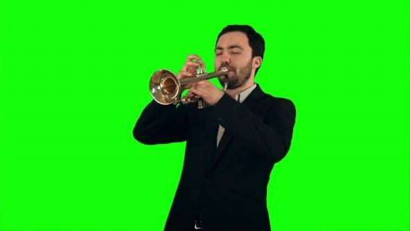Cover Image for Young Musician Playing Trumpet On a Green Screen
