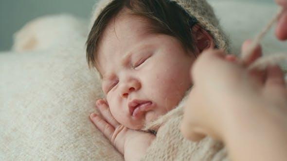 Thumbnail for Cute Newborn Baby Sleeping On a Blanket