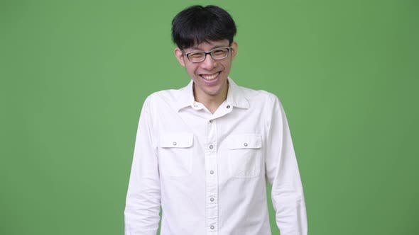 Thumbnail for Happy Young Asian Businessman Laughing