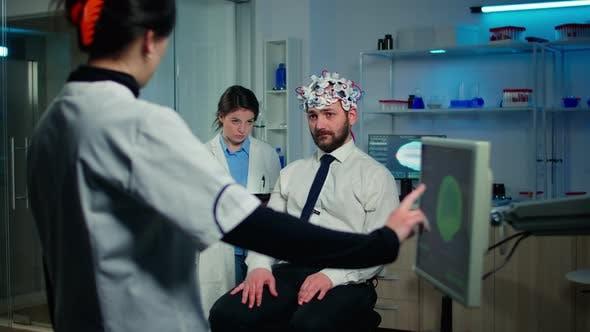 Man Patient Participating at Neurological Experiment