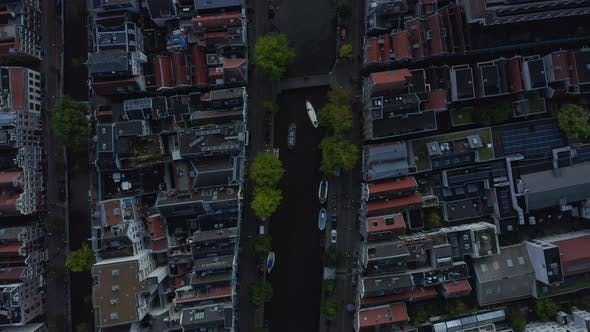 Thumbnail for Overhead Birds View of Amsterdam Neighbourhood and Canal with Boats, Aerial Drone View