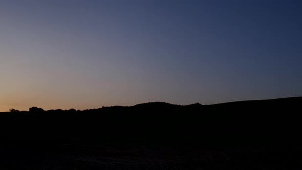 Thumbnail for The Sun Rises Over the Hill. Illuminated Sandy Beach with Traces of Tires.